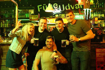 half a dozen young people partying at a Fuge Udvar bar
