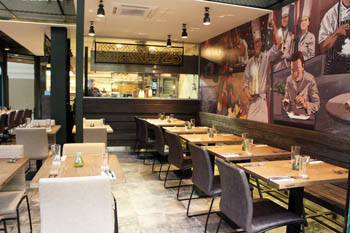 tables set inside Stand 25 bistro