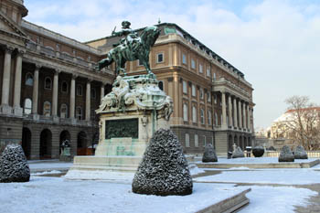 an equestrian bronze statue at one of the terraces of the Royal Palace in winter