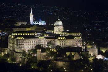 The Royal Palace, Matthias Church illuminated at night, photographed from Gellért Hill