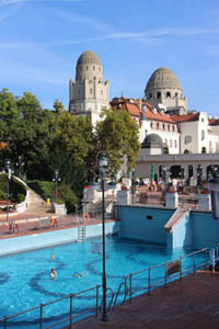 the Gellert Hotel's building and the oudoor pools on a clear summer day
