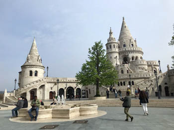 the white turrets of the bastion, tourists taking selfies and photos
